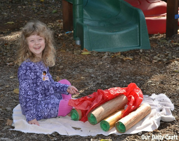 playing with a campfire play set