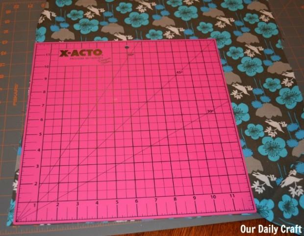 cutting fabric to make cloth napkins.