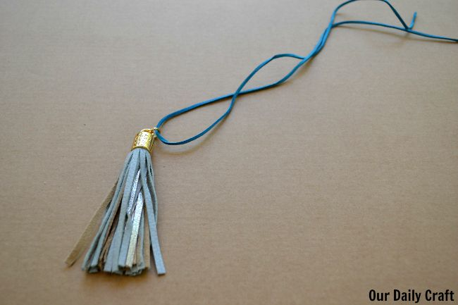 string tassel onto suede