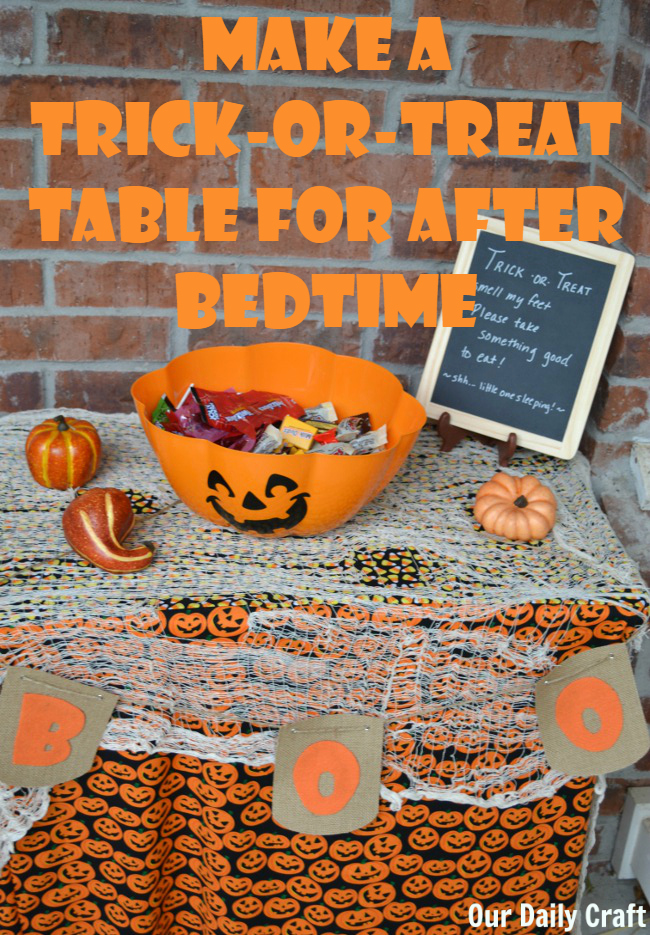 Make a cute trick-or-treat table for the porch so kids can get candy without ringing the doorbell.