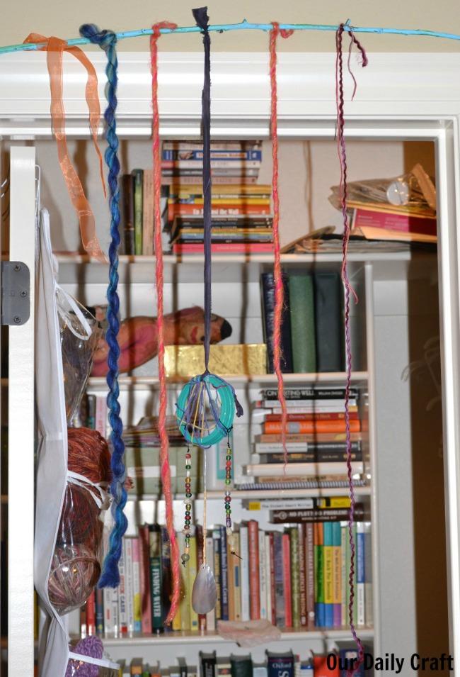 yarn wall hanging over door