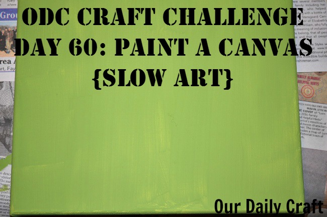 Paint a canvas a solid color to begin a slow art project.