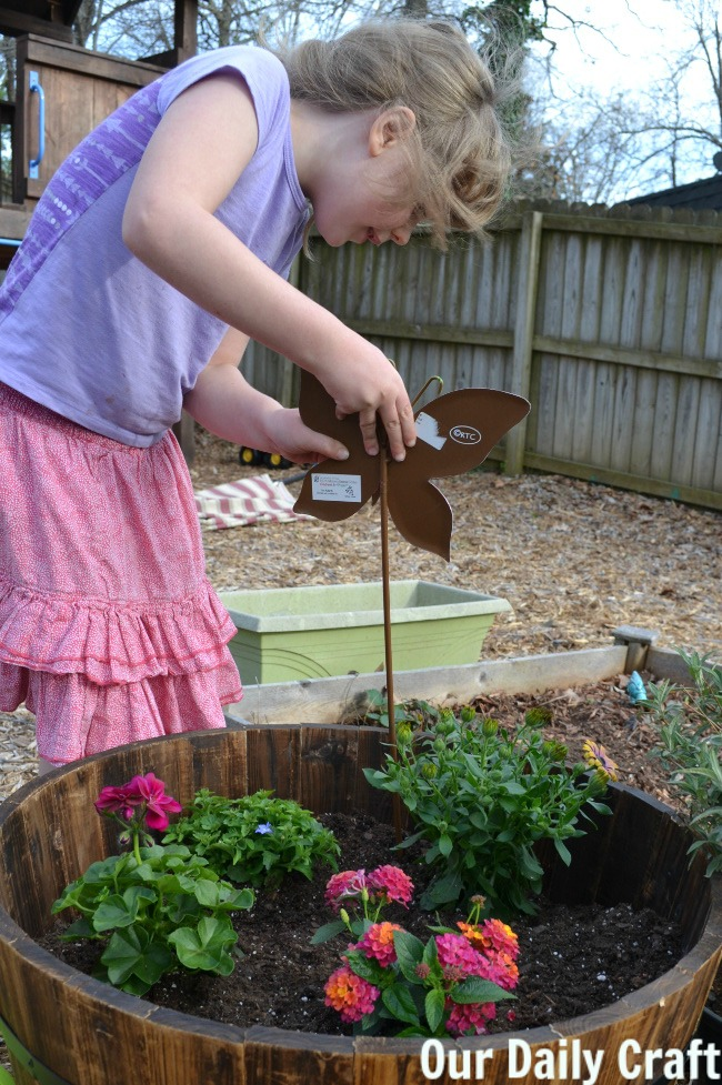 adding butterfly art to garden