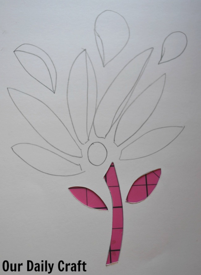 cutting out cut paper flower
