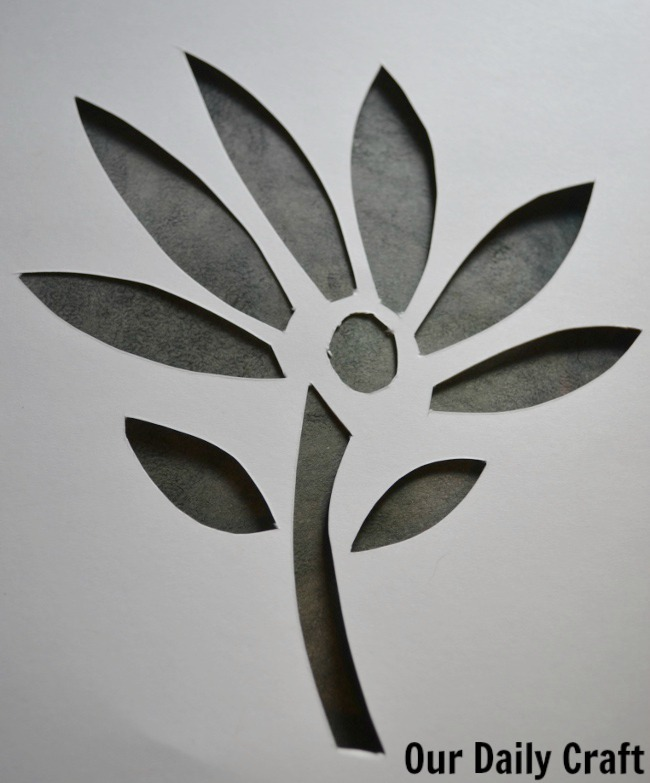 cut paper flower overlay on art
