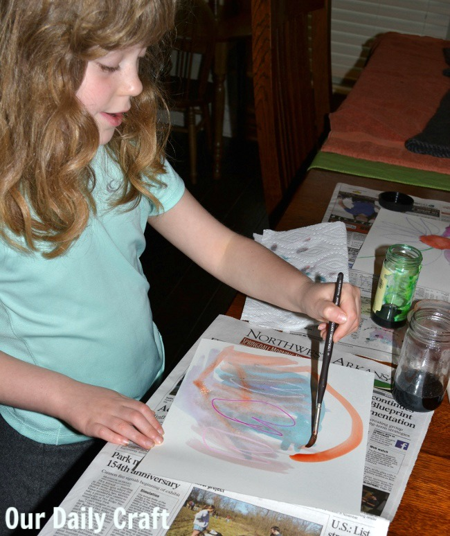 painting with watercolors on crayon