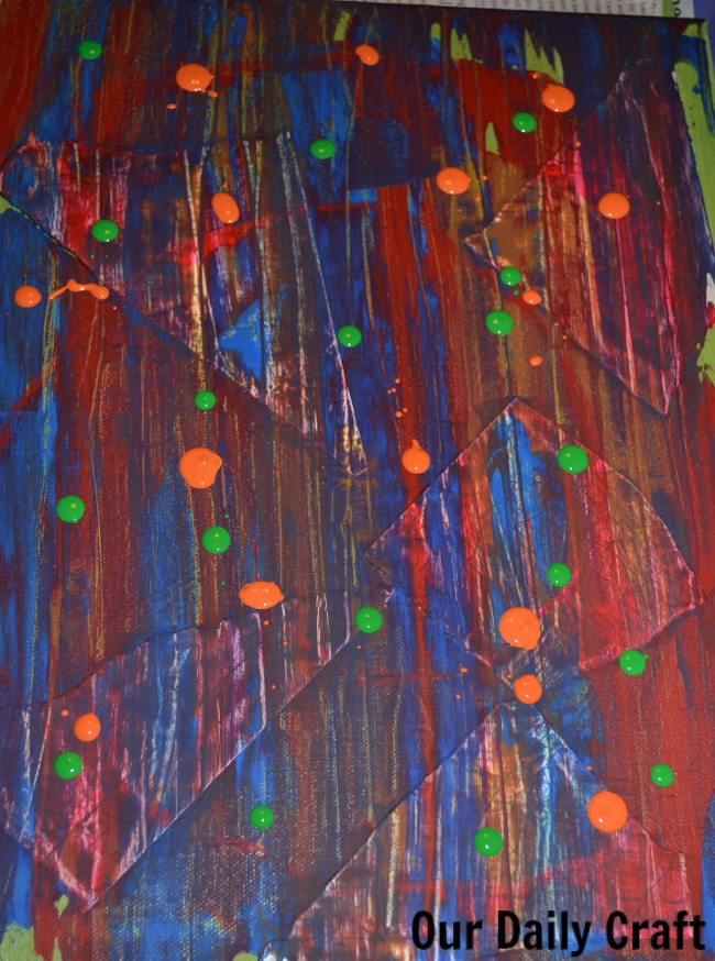 dots of paint on canvas