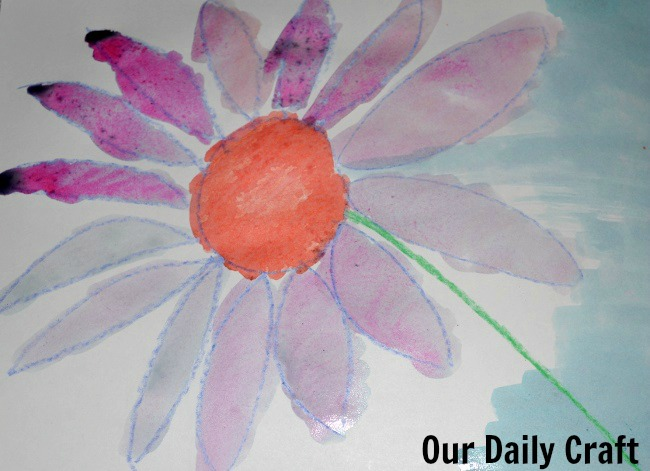 watercolor painting over crayons