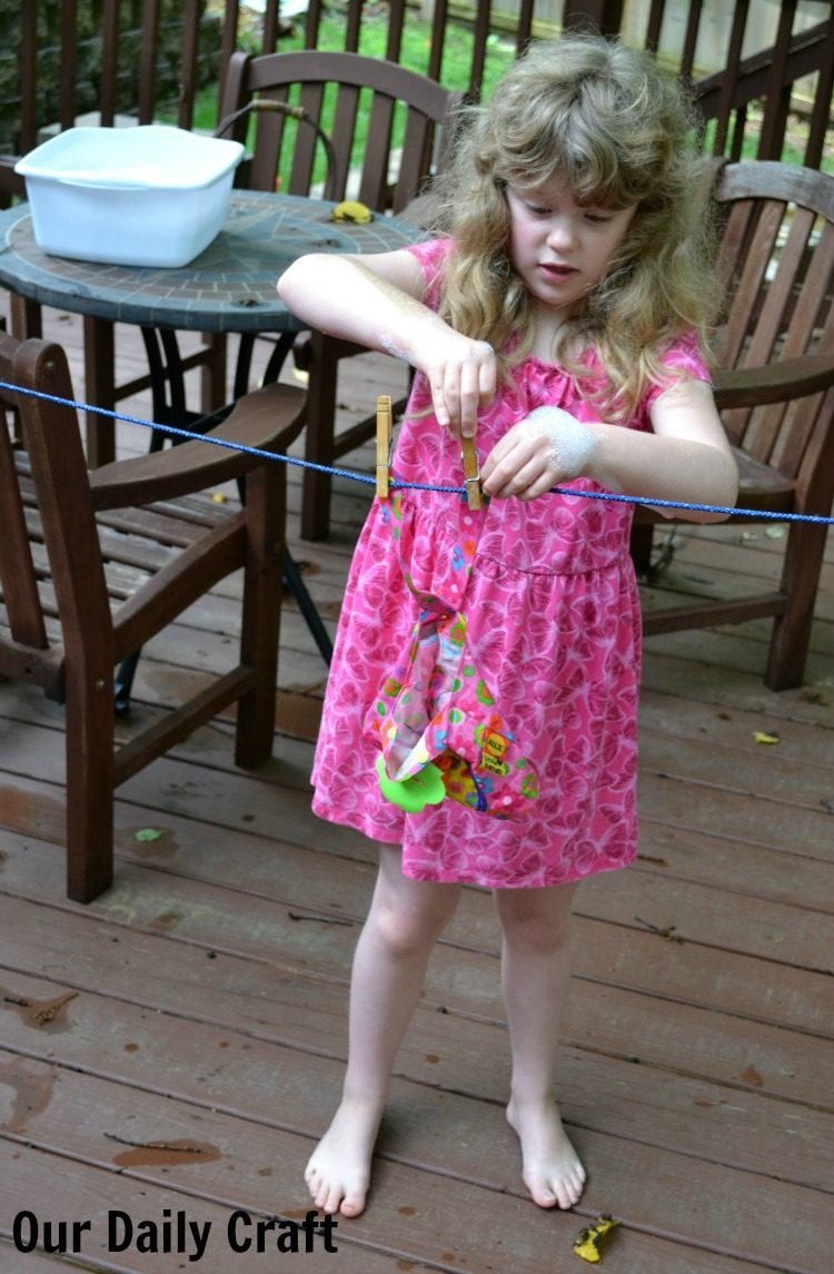 Washing doll clothes is a fun and easy activity for summer that gets kids into water.