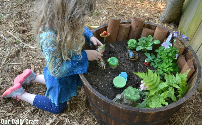 playing with fairy garden