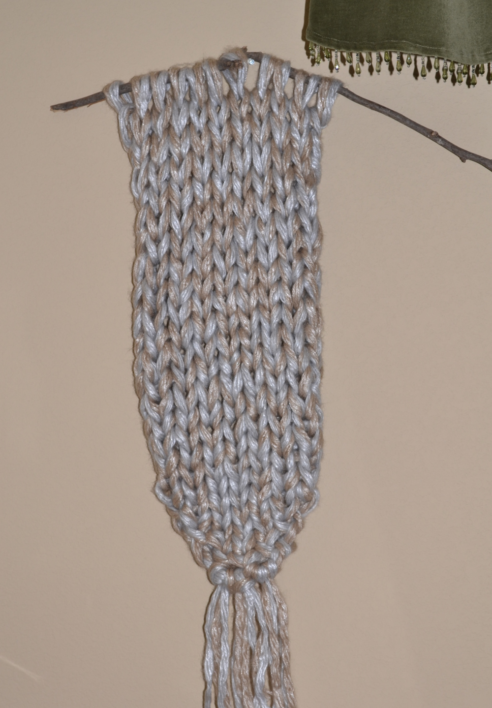 knit wall hanging on stick