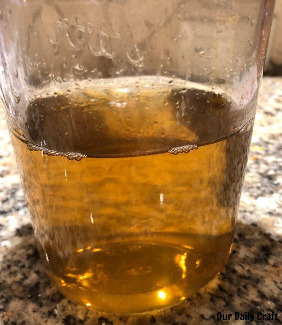 homemade rose water in jar
