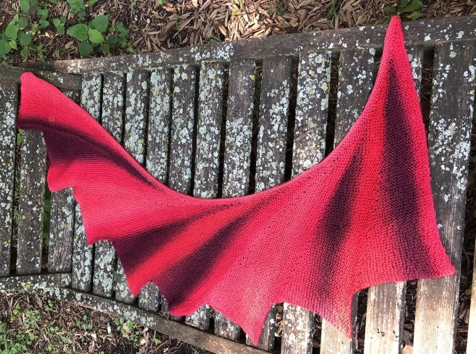 wingspan shawl on a weathered wooden chair